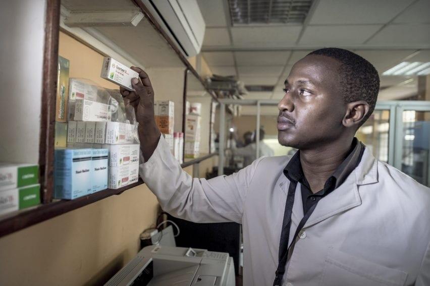 A member of staff checks a malaria medication