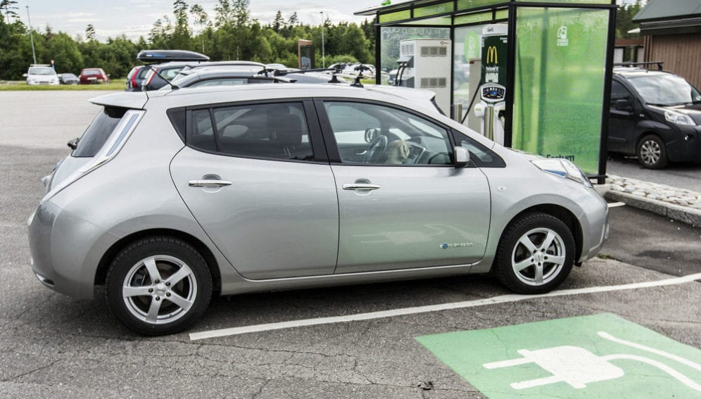 An electric car parked at a charging station