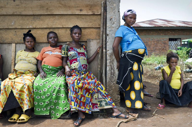Pregnant woman wait to be seen at a rural antenatal clinic