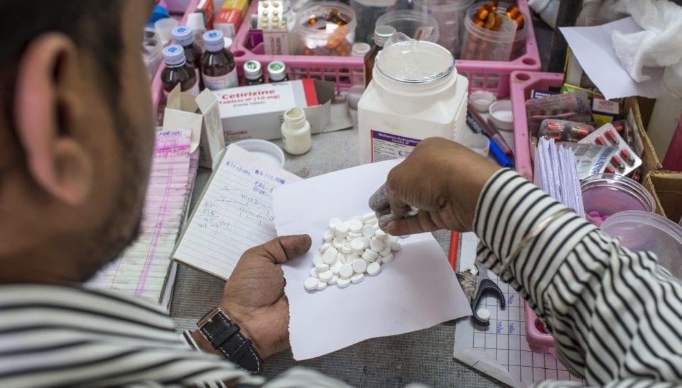 India man in pharmacy
