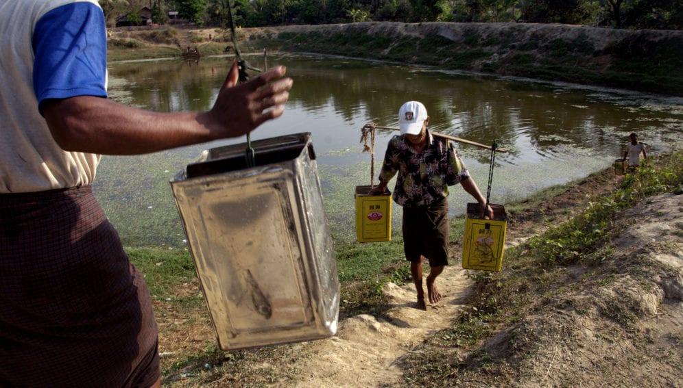 men hauling water from reservoir_panos