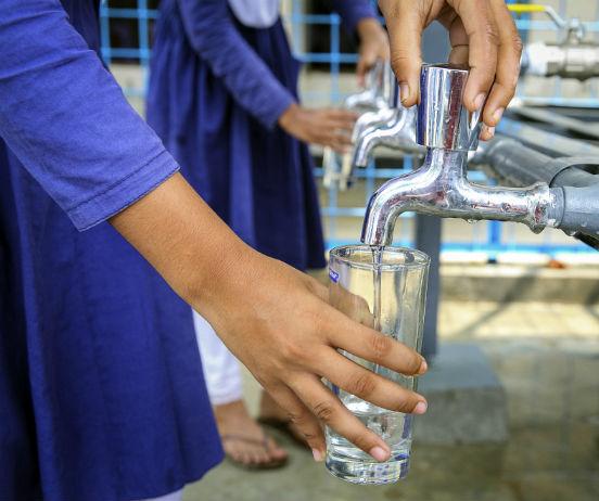 Schoolgirls getting drinking wate