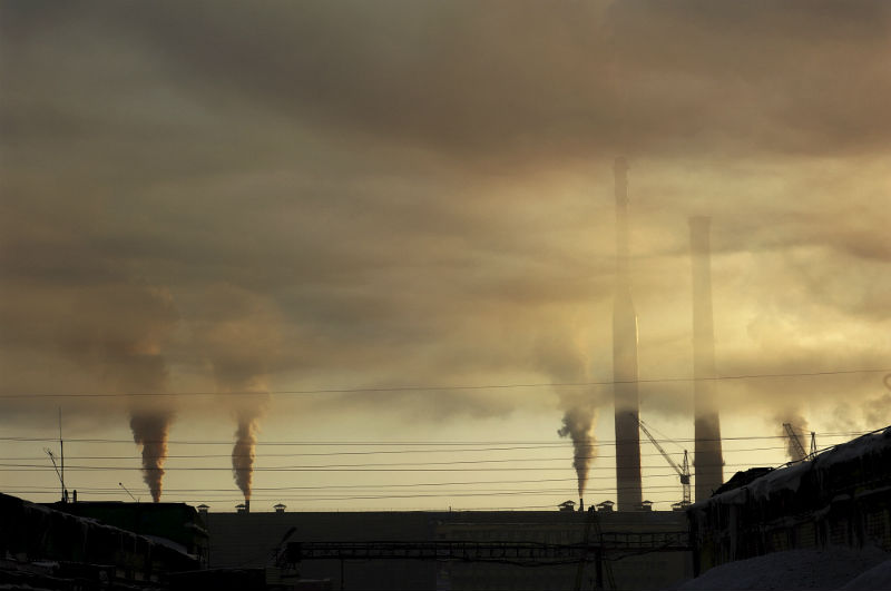 Smoke stacks belch out polluted air