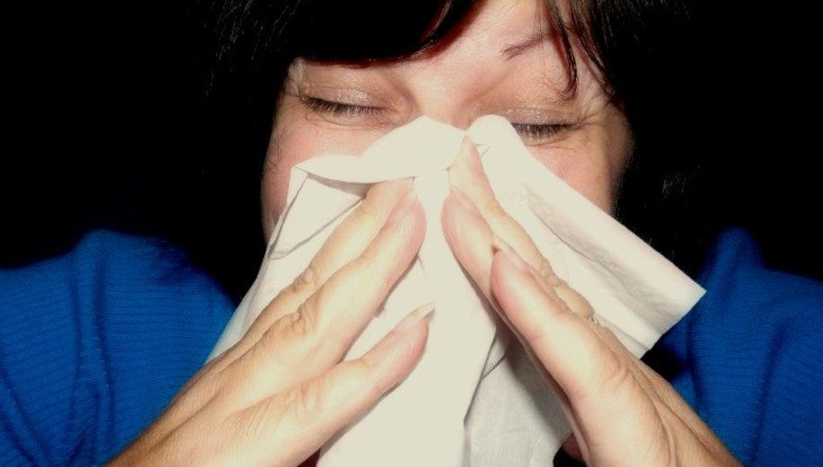 sneezing woman - main