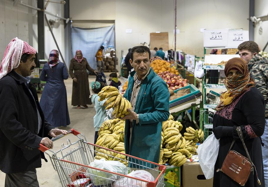 Jordan's Syrian refugees to get food aid in cash