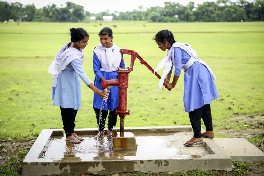students getting water