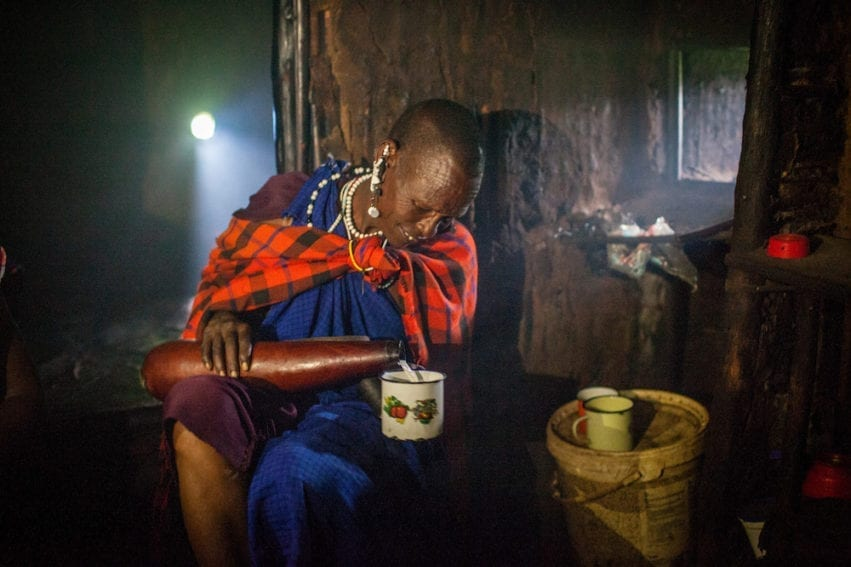 An elder drinking milk inside a traditional home. Milk is normally boiled, but some elders prefer the taste of unboiled milk. Drinking unpasteurised milk increases the likelihood of disease and parasite transmission
