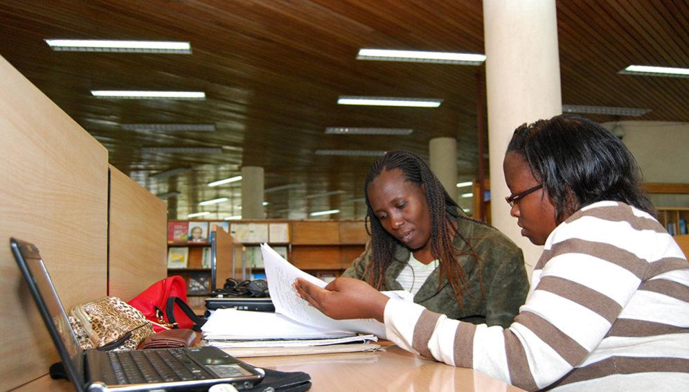 Radio Nigeria Staff studying a document
