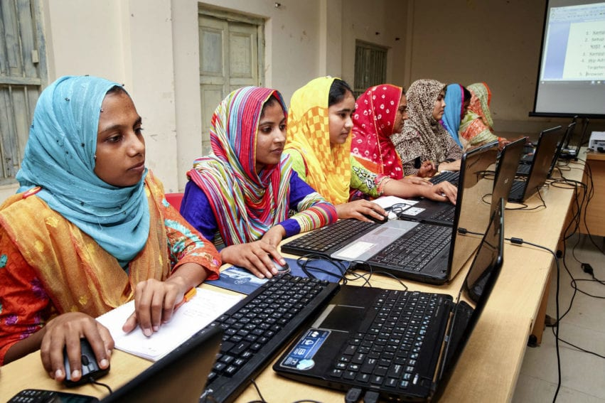 A group of young women of receiving computers