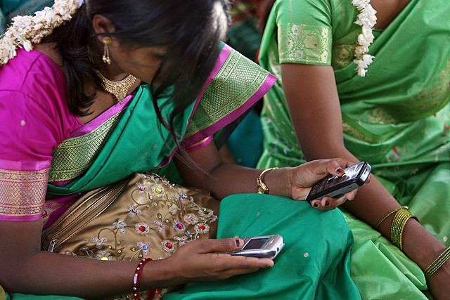 Checking_mobiles_Flickr_World Bank Photo Collection.jpg
