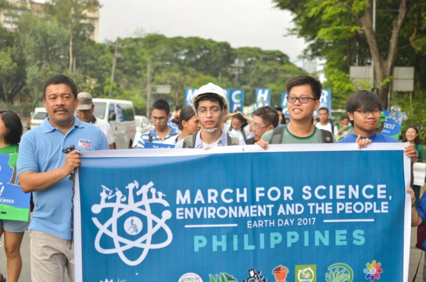 The Philippines: Supporters walk through Manila with a banner for Kalikasan PNE, an environmental network, one of the science organisations that marched through the capital.