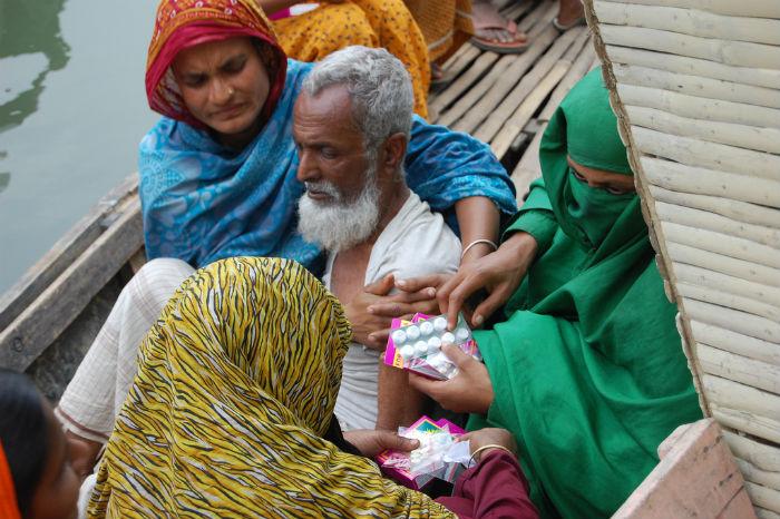 man getting treatment in bangladesh.jpg