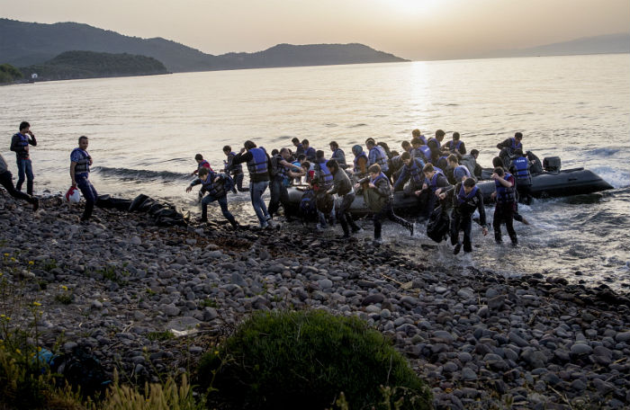Refugees escape by boat.jpg