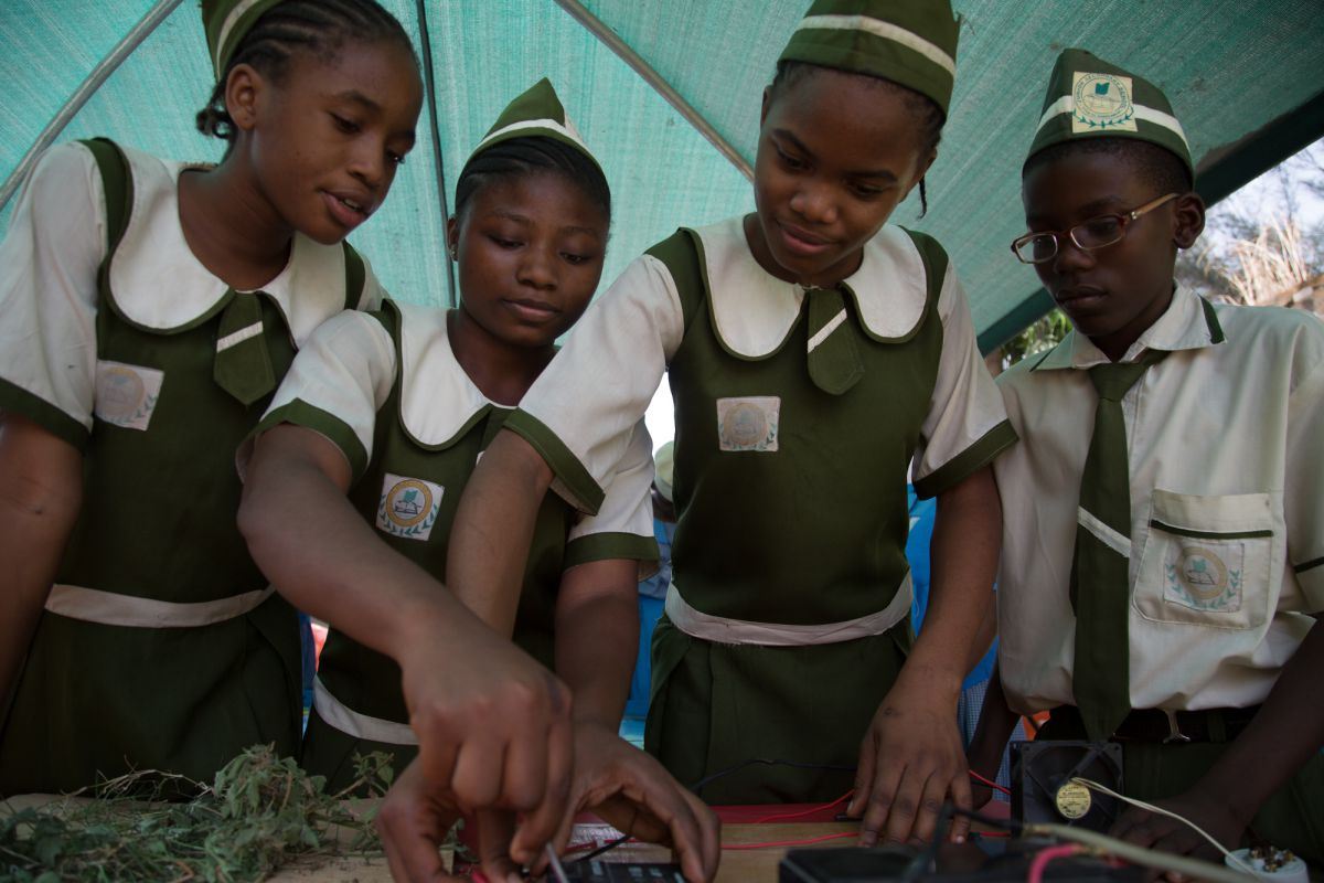 Pupils from Junior Secondary School Area 11 with their solar power project, demonstrating how solar cells can power household fittings, including a fan and light bulb. Uhegbu Ljeoma (far left) says the project opened her eyes to the world of science. She is now determined to pursue a career in technology