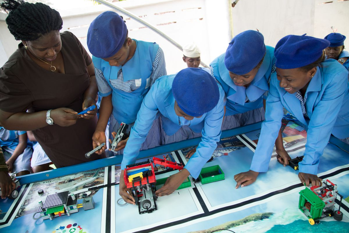 Stella Uzochukwu-Denis from the Odyssey Educational Foundation shows girls from Government Girls Secondary School Dutse how to build a robot. The foundation hosted the First Lego League challenge, in Abuja. In this competition, students programmed Lego robots donated by the toy firm to achieve a waste-based goal