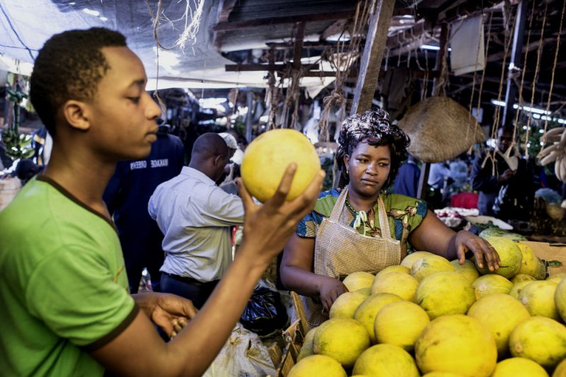 trader selling melons