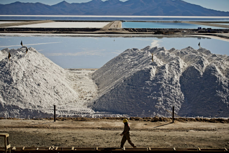worker strides past huge deposits of potassium chloride