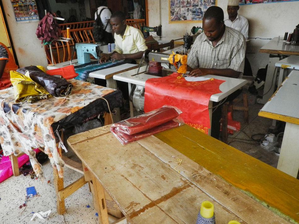 Refugees working alongside Ugandans as tailors in Kampala.