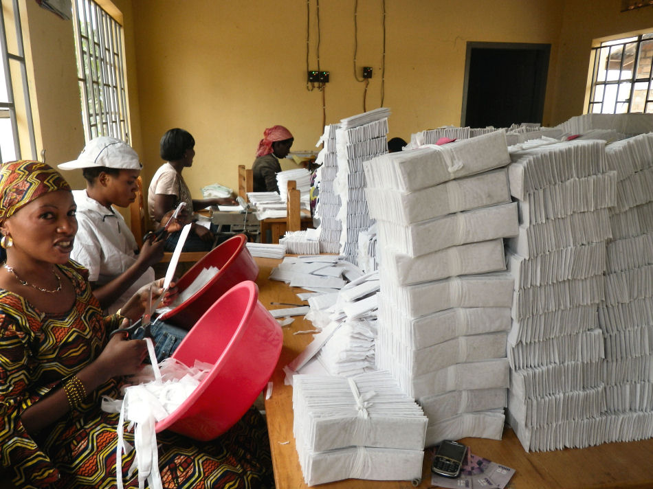 Workers making MakaPads — women's sanitary pads made from recycled office paper and locally grown papyrus — at a factory in a refugee settlement. The pads are cheaper and more environmentally friendly than imported products.