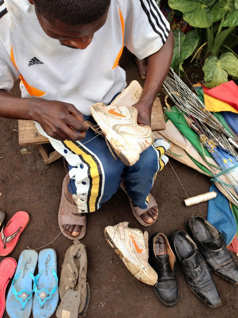 A Congolese refugee repairman in Kyangwali refugee settlement.