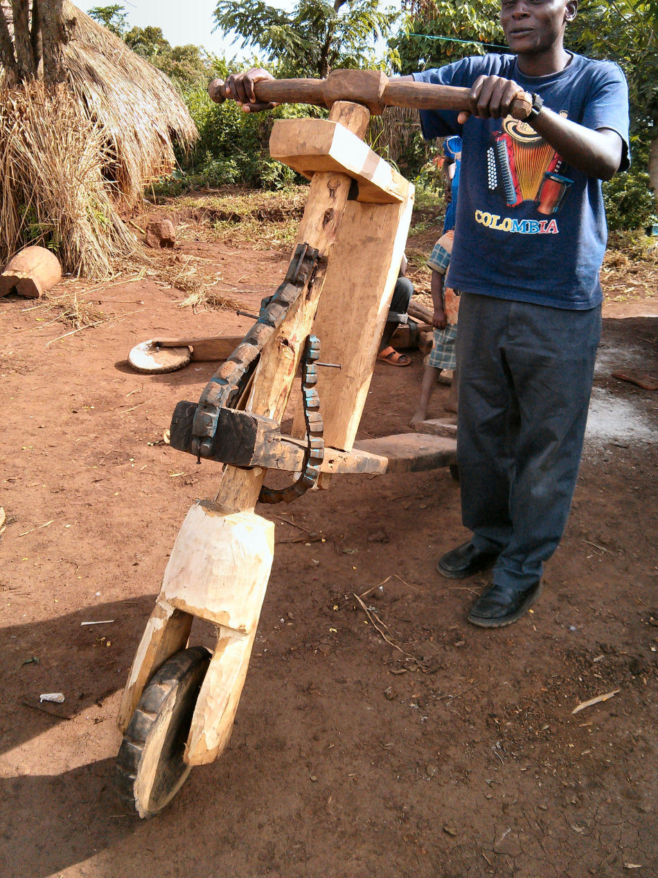 A handmade wooden bike for transporting goods in Kyangwali refugee settlement. Such bikes are made from locally available resources, including wood and old vehicle tyres.