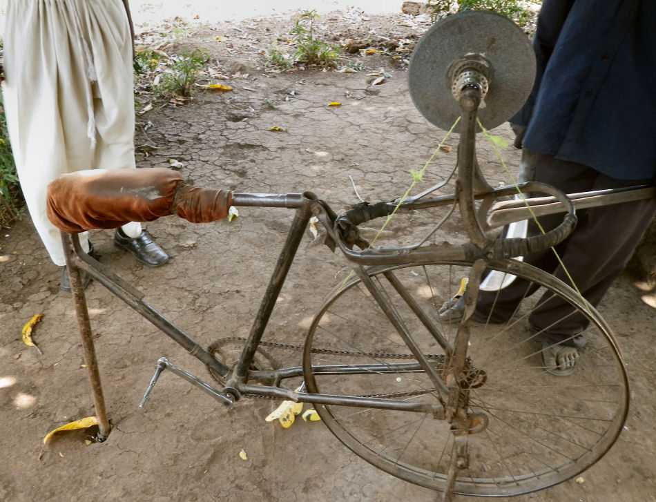 An adapted bicycle for sharpening farm tools in Nakivale refugee settlement.