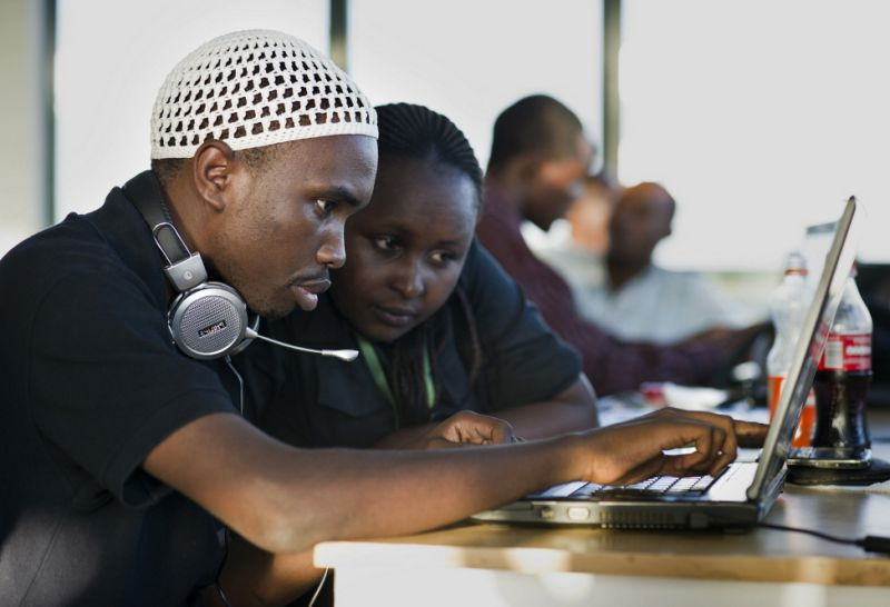 Young people use a computer at iHup