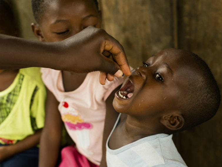 A child receiving a dose of vitamin