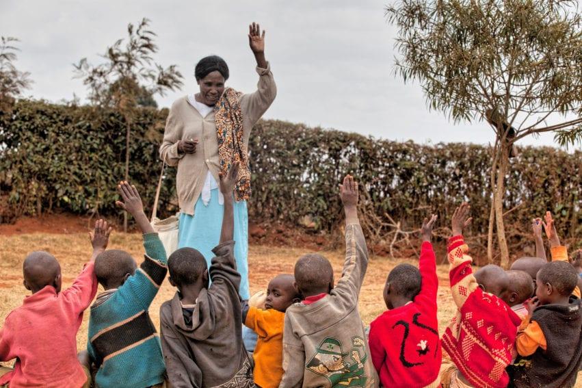 children taking malaria lessons