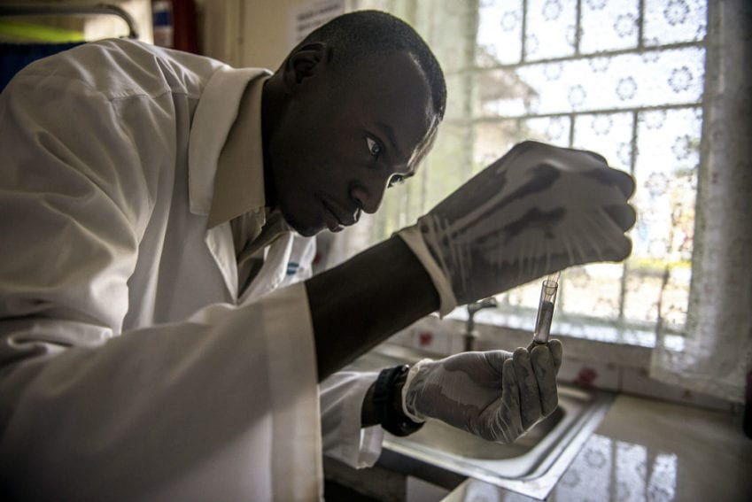 Laboratory technician Denis Bongoyinge prepares a blood sample