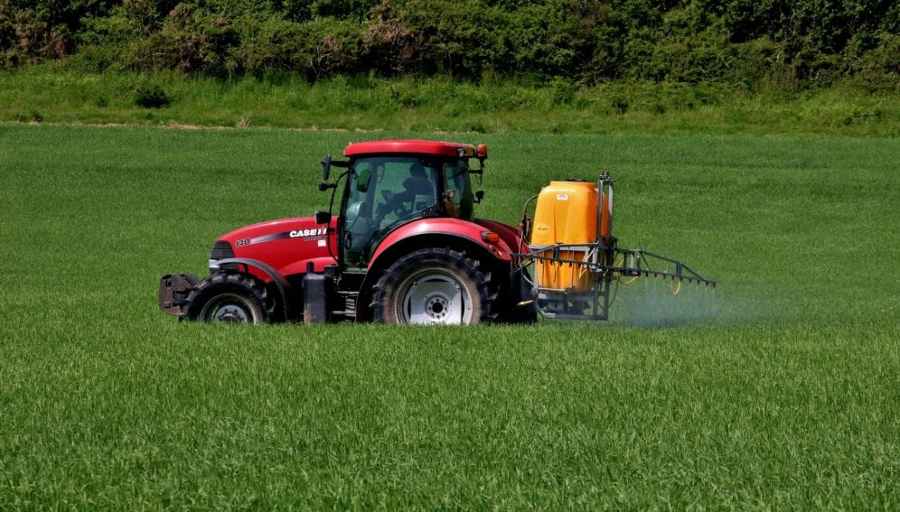 Tractor spraying what firm