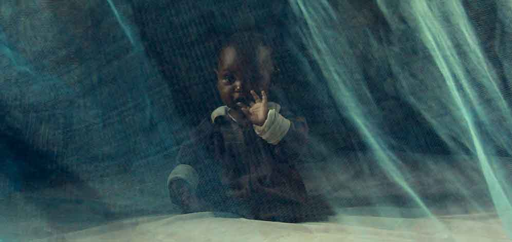 Baby protected by mosquito net